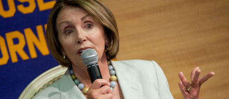 """Speaker Nancy Pelosi, introduced by Zoe Lofgren as """"the most powerful woman in the world,"""" was warmly received at Wednesday's Rotary lunch meeting. Photograph by Peter Carter."""