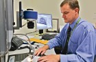 Tim Fayle, a latent print examiner at the Santa Clara County Sheriff's Office, goes through the procedure of identifying an unknown fingerprint. (Photo by Chip Scheuer)