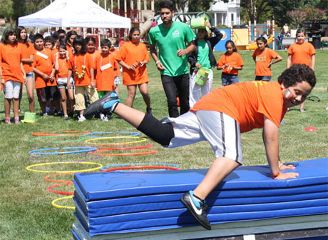 Children take part in the Junior Games, which is among several programs that provide fitness activities and education for at-risk youth through San Jose's Parks and Community Centers (Photo by Zak Mendez).