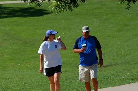 A couple takes a morning walk through Almaden Lake Park. (Photo by Ray Rodriguez)