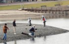 A group of men fish at Almaden Lake, although it seems unlikely they ate any catch considering the high levels of Mercury contamination in the water. (Photo by Don DeBold, via Flickr)