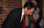 District Attorney Jeff Rosen takes a bow after winning election in 2010. (File photo)