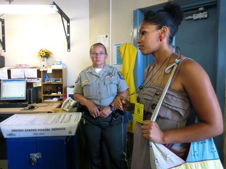 """Stacey """"Steeda"""" McGruder, right, helped bring awareness to a proposal by the Sheriff's Office to limit jail mail to postcards. The proposal was scrapped last week. (Photo by Jennifer Wadsworth)"""