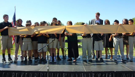 Students take part in a ribbon-cutting ceremony held last year at Alpha: Blanca Alvarado Middle School.