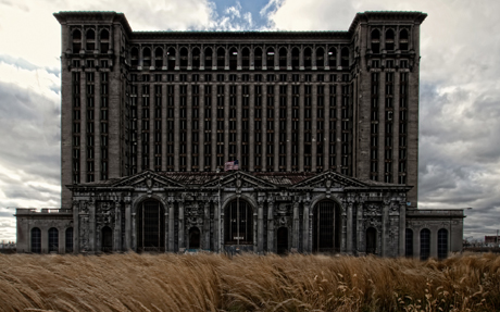 Michigan Central Station sits empty and broken, looming over Detroit like a mausoleum. (Photo by Justin Mier, via Flickr)