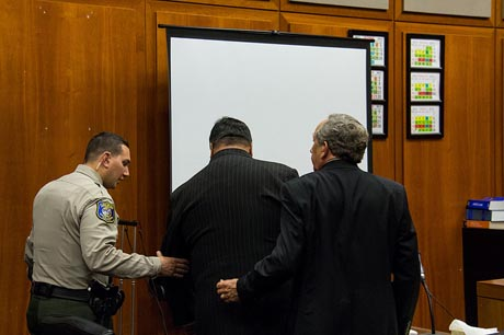 Once the top elected official in Santa Clara County, George Shirakawa Jr., middle, was immediately remanded after receiving a one-year jail sentence Friday for his pilfering of campaign funds. (Photo by Geoffrey Smith)