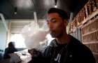 Brandon Vargas exhales vapor from a vape pen at Elements SJ.