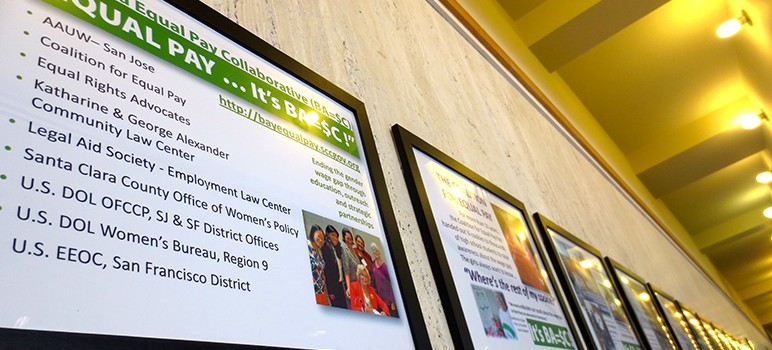 An exhibit at the County Government Center highlights the problem of pay disparity between men and women.