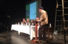 James Reber makes introductory remarks at the mayoral forum held Monday at San Jose Stage Company.