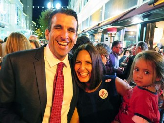 Sam Liccardo, celebrating here with wife Jessica and a borrowed baby, will face off against Dave Cortese in November for mayor of San Jose.