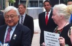 Congressman Mike Honda, left, and Lynn Walton, who has a gay son barred from donating blood to help his younger brother, speak at a press conference held Monday outside the county building.