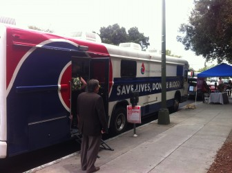 A mobile blood bank parked just outside the county building.