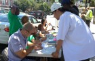 Volunteers gave out vouchers for free medical marijuana evaluations Thursday across the street from City Hall.