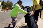 Downtown Streets Team's volunteers work to clean up trash and debris on a San Jose roadway near Coyote Creek.
