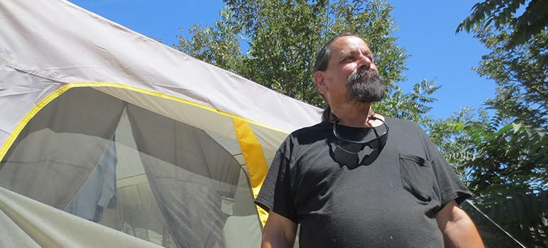 "Robert Aguirre, 60, received a notice Friday night ordering him to pack up and leave ""The Jungle"" homeless encampment."