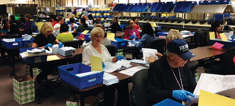 County employees worked 12-hour shifts each day last week to sort and count the 140,000-plus vote-by-mail ballots. (Photo by Josh Koehn)