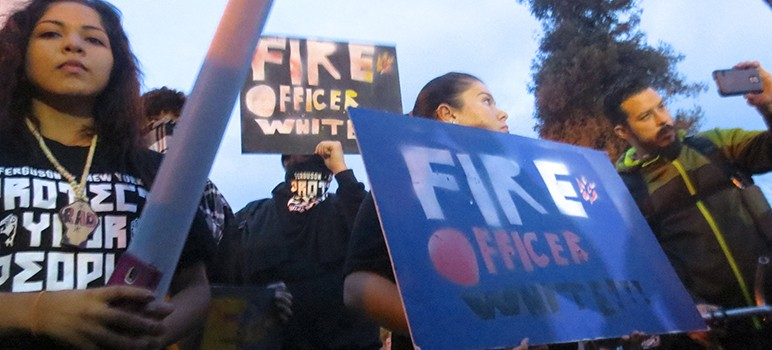 Demonstrators marched on San Jose police headquarters Thursday to demand the city fire Officer Phillip White for his inflammatory views espoused on Twitter. (Photo by Jennifer Wadsworth)