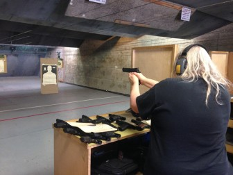 Nikki Stallard shoots a handgun during target practice at the Santa Clara Valley Rifle Club.