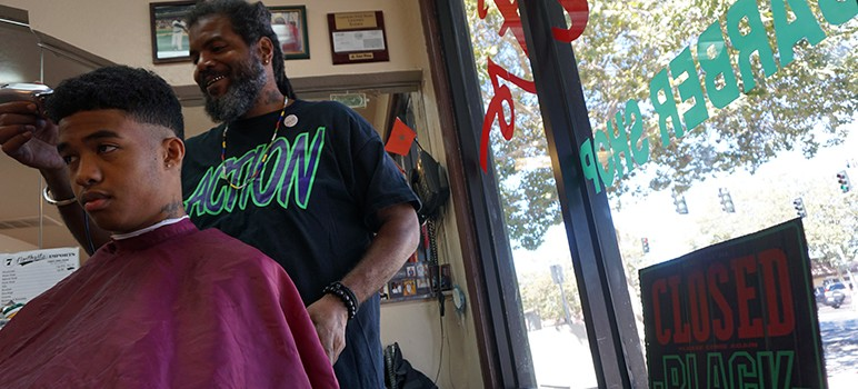 Raab Bui, who runs Giants Barbershop, says he's lost customers because of construction outside.  (Photo by Jennifer Wadsworth)