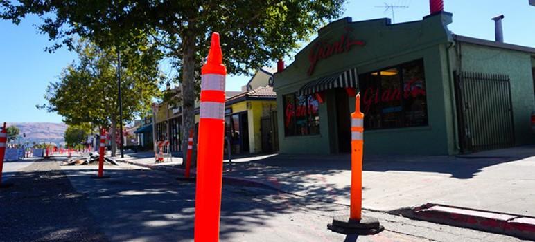 A maze of cones and dug-up asphalt makes it hard to navigate Alum Rock Avenue. (Photo by Jennifer Wadsworth)