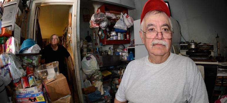 Juan Salcedo works two minimum wage jobs just to afford rent for a garage where he and his sister live. (Photo by Greg Ramar)