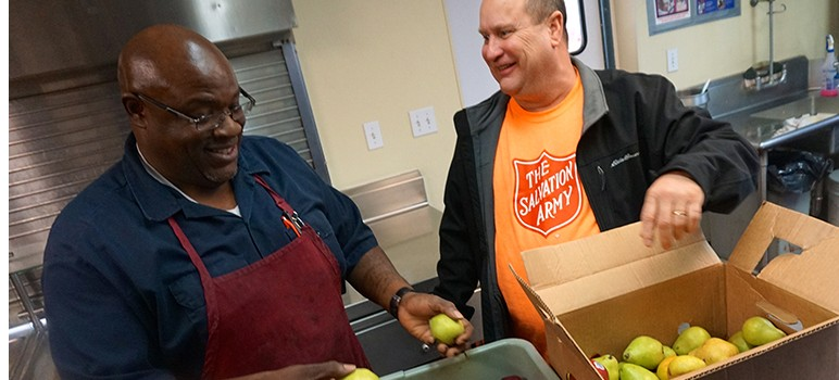 Salvation Army chef Tony Williams and Daniel Guhl rely on a mobile app to find unused food from hotels, venues and restaurants to feed the hungry. (Photo by Jennifer Wadsworth)