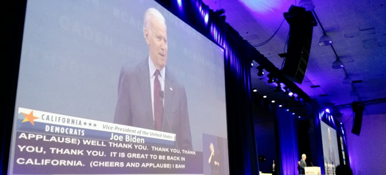 Vice President Joe Biden received a huge round of applause, which was only made better by closed caption. (Photo by @CoCoYoungDems, via Twitter)
