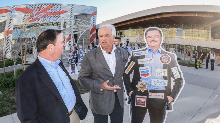 John Cox, center, confrtoned Assmeblyman Rich Gordon (D-Palo Alot) with his own cardboard cutout Friday outside of the the Democratic Party convention in San Jose. (Photo by Greg Ramar)