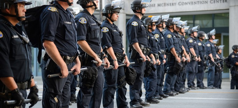 SJPD hold the line at Donald Trump's rally in San Jose last year. (Photo by Greg Ramar)