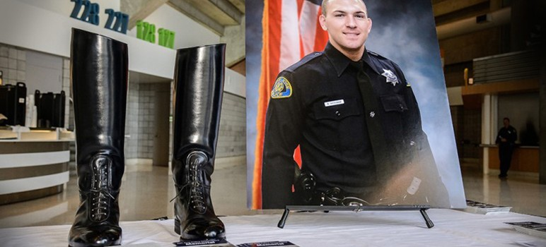 Officer Michael Katherman's department-issue boots were displayed at his public memorial service. (Photo by Greg Ramar)