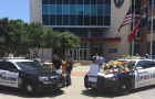Dallas police set up a memorial outside of department headquarters a day after a sniper killed five officers and injured seven more. (Photo via Twitter)