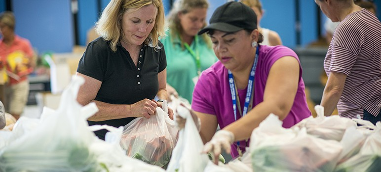 A large number of people who donate to and volunteer for Second Harvest Food Bank have relied on the nonprofit's services for their own families. (Photo courtesy of Second Harvest Food Bank)