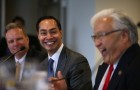 Housing and Urban Development secretary Julian Castro (center), pictured with Santa Clara County Supervisor Dave Cortese (l) and U.S. Rep Mike Honda (r), visited Silicon Valley April 8, 2016 to tour a Sunnyvale housing facility for recently homeless vets. (Photo by Justin Sullivan/Getty Images)