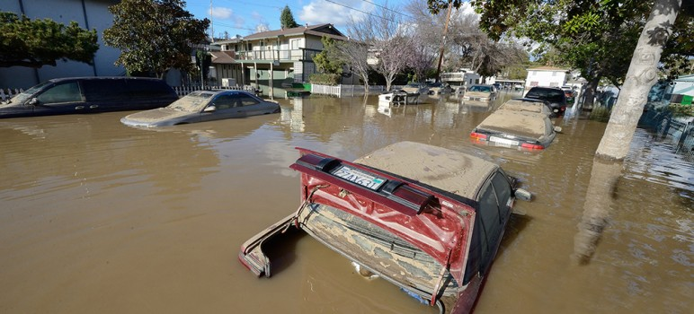 Many vehicles were ravaged by flood water as residents received little or no warning. (Photo by Greg Ramar)