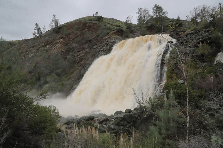 Anderson Reservoir reached the emergency spillway for the first time since 2006, creating a waterfall into Coyote Creek. This photo was taken Feb. 19. (Photo by Robert Eliason, via Morgan Hill Times)
