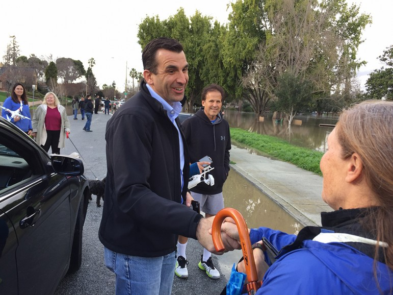 San Jose Mayor Sam Liccardo visited with residents in Naglee Park the day of the flood but had little info to share. (Photo by Dan Pulcrano)