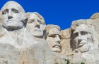 The Mount Rushmore National Memorial sculpture features the faces of four American Presidents: George Washington, Thomas Jefferson, Teddy Roosevelt, and Abraham, Lincoln, at Keystone, South Dakota. (Photo via Shutterstock)