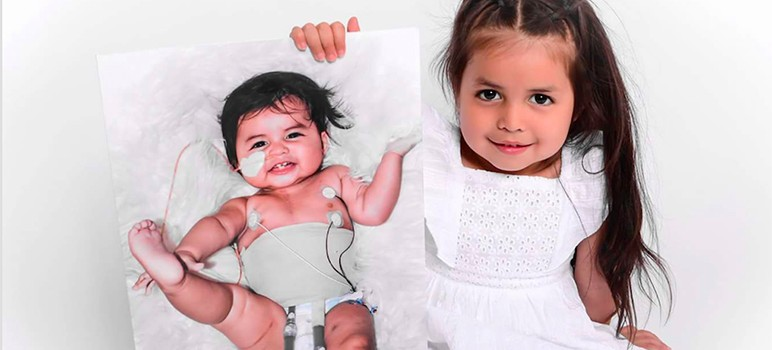 Gigi Vidales poses with a portrait of herself as a baby attached to an artificial heart. (Photo by Virginia Becker)