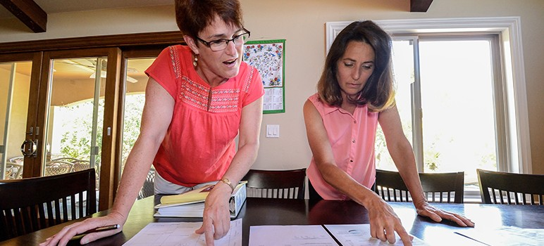 Ginny Hoerger (left) and Rita Benton conducted an analysis of San Jose Water Company bills, which they say proves the company overcharged residents by as much as $13 million. (Photo by Greg Ramar)
