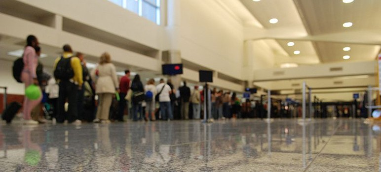 Few things can inspire despair like a long Airport security line. (Photo by Josh Hallett, via Wikimedia Commons)