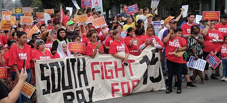 Hundreds of workers and their allies rallied for better pay and working conditions on Labor Day. (Photo by Bernie Bob Jung)