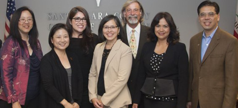 Santa Clara County Board of Education trustee Michael Chang (pictured far right) announced his resignation on Tuesday. (Photo via SCCOE)